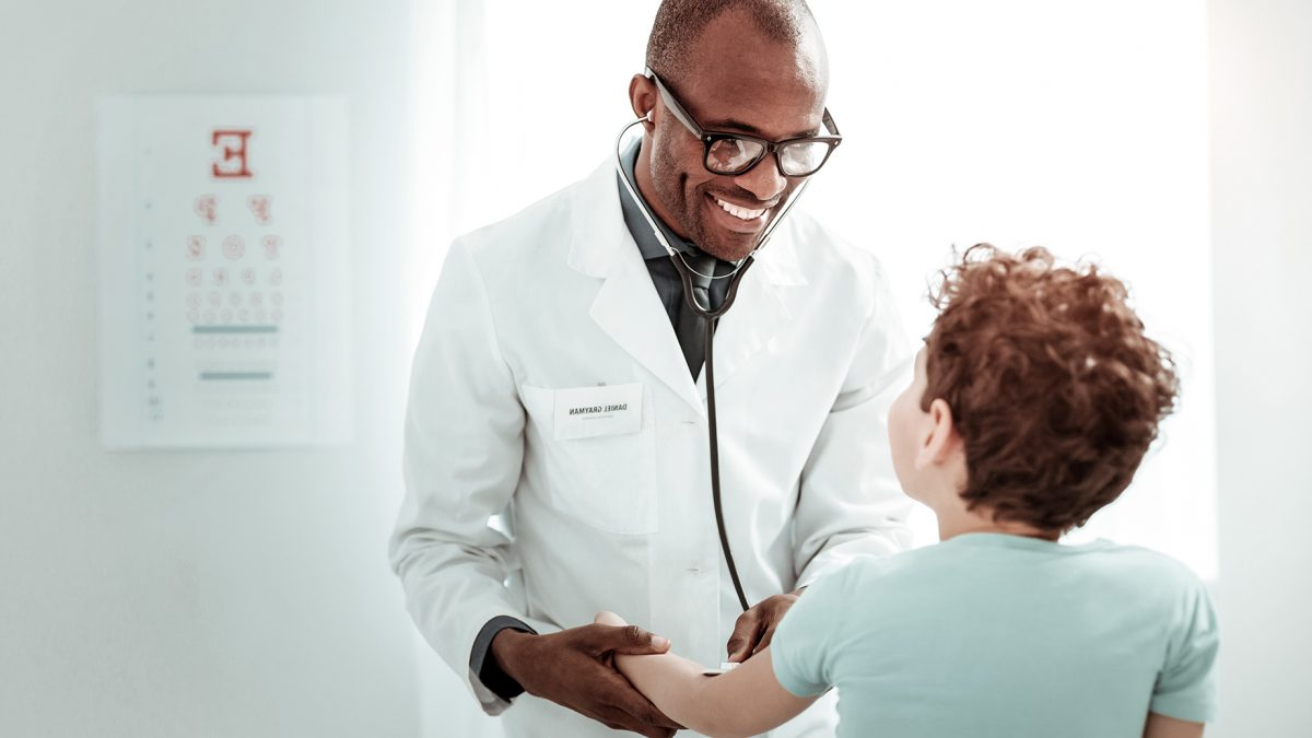 Pleased international medical worker having pleasant talk   MoneyShop